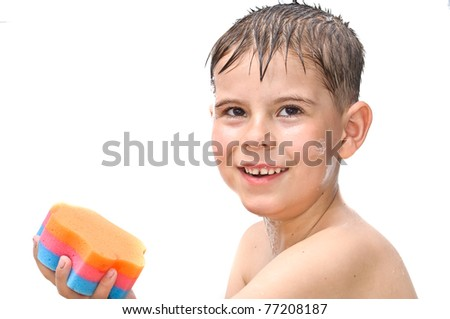 A boy swims in the bathtub. Isolated on white background picture - stock photo