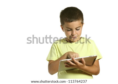 a boy with a tablet computer isolated on white background - stock photo