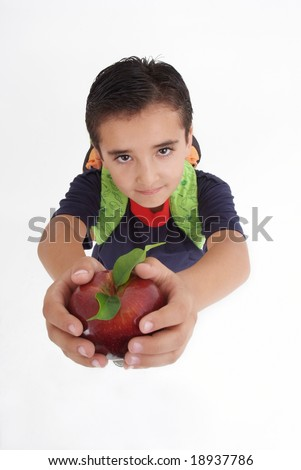 A boy with backpack and apple looking at camera - stock photo