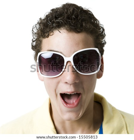A boy with funky white sunglasses screams - stock photo