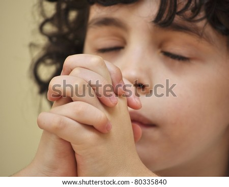 A boys talks to his creator with humility and devotion - stock photo