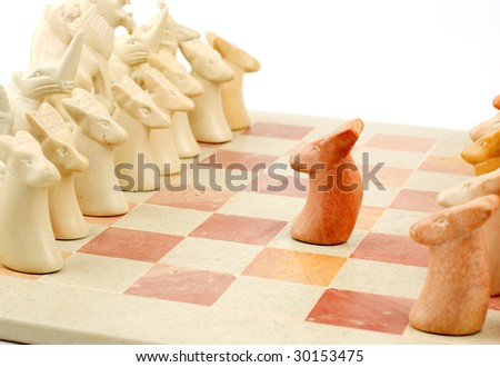 A brave lone stone pawn making the first move in a chess match - stock photo