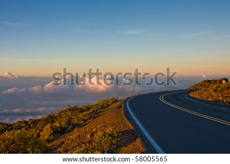 A breathtaking view of the sky at sunrise on the road to the top of the Haleakala Volcano. Maui, Hawaii. - stock photo