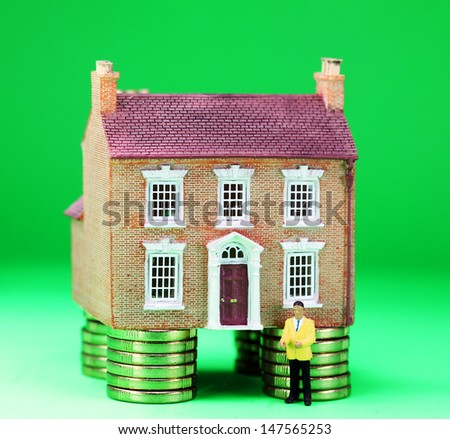 A brick house placed on good financial foundations, with a great green background asking the question are you ready to purchase this red hot property, whilst the real estate agent waits for you! - stock photo