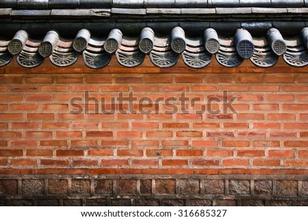 A brick wall of a Korean historical palace with high contrast - stock photo
