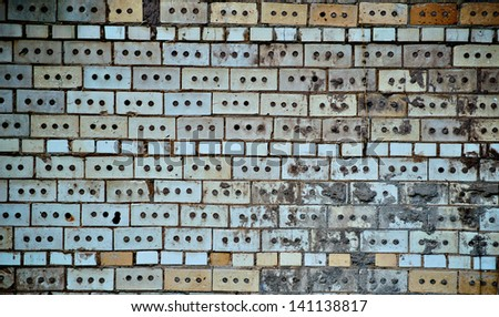 A brick wall of an old building. - stock photo
