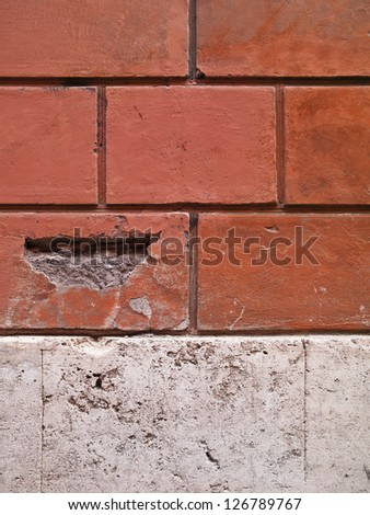 A brick wall which is actually a brick pattern stamped into the wall - stock photo