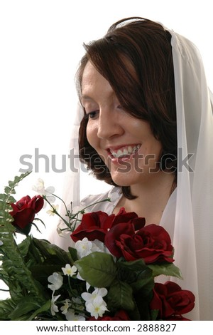 A bride holding a bouquet of flowers - stock photo