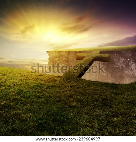 A bridge across a chasm made out of the shape of a cross - stock photo