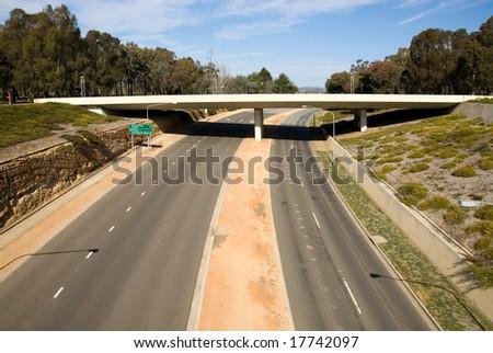 A bridge over a motorway in Canberra, Australian Capital Territory, Australia - stock photo