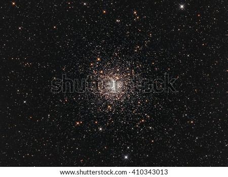A bright globular cluster called Messier 4 or M4 or NGC 6121 in the constellation Scorpius taken with camera and medium focal length telescope - stock photo