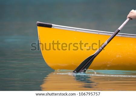 A bright morning canoe trip begins. - stock photo
