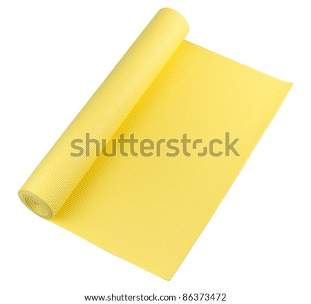 A bright yellow yoga mat for your exercise - stock photo