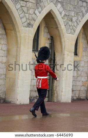 A British guard marching at Windsor Castle (England) - stock photo