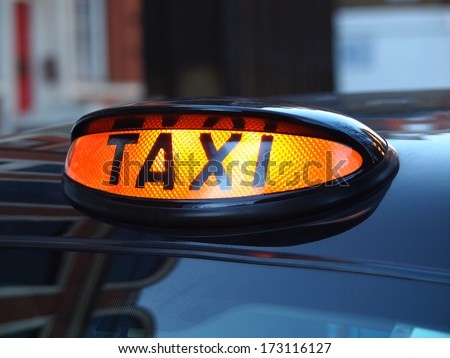a british london black taxi cab sign  with colorful background         - stock photo