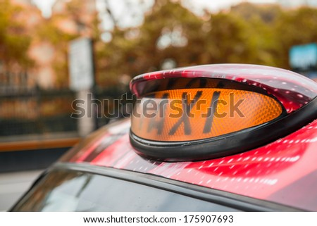 A british london black taxi cab sign with colorful background. - stock photo