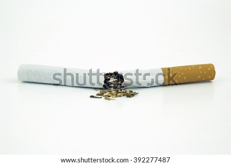 A broken cigarette isolated on white - stock photo