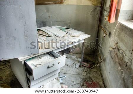 a broken desk in an old ruin - stock photo