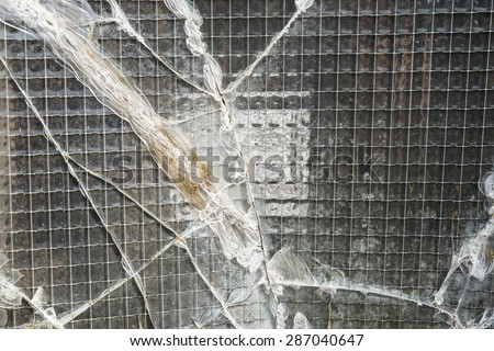 A broken industrial security window.  - stock photo