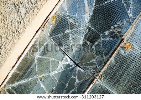 A broken industrial security window.