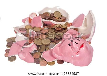 A broken piggybank with chump money - stock photo