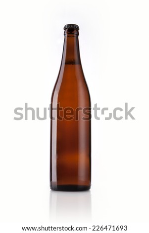 A brown beer bottle on the reflective bottom isolated white. - stock photo