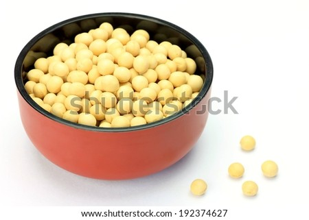 A brown bowl with a various white beans in it. - stock photo