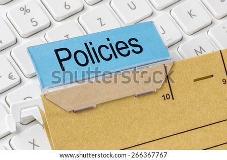 A brown file folder labeled with Policies - stock photo