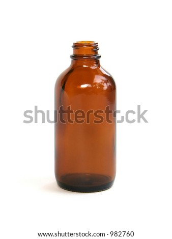 A brown homeopathic medicine bottle. - stock photo