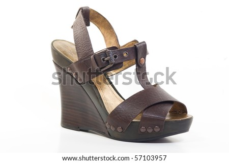 A brown leather platform wedge - stock photo