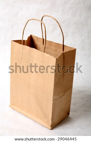 a brown paper bag isolated on a gray background - stock photo