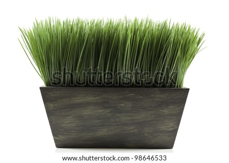 a brown planter box with green grass - stock photo