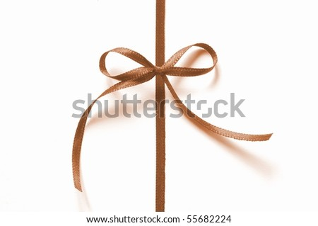 a brown ribbon with bow isolated on white background - stock photo