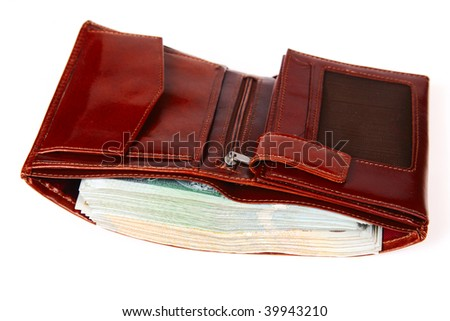 A brown wallet full of money isolated on a white background - stock photo