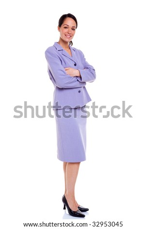 A brunette businesswoman standing with her arms folded wearing a lilac suit, isolated on a white background. - stock photo