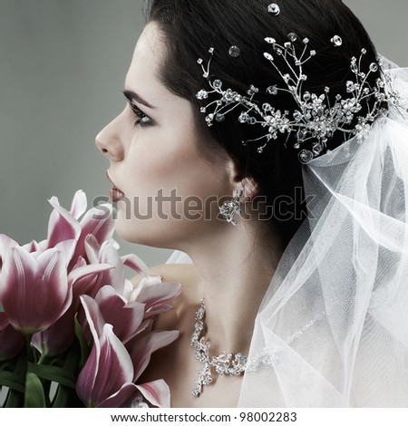 A brunette is beautiful in a wedding-dress, wedding decoration - stock photo