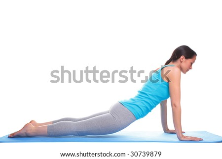 A brunette woman doing stretching exercises on a yoga mat, isolated on a white background. - stock photo