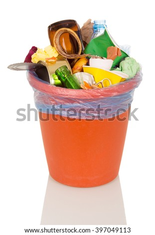 A bucket filled with household waste and food isolated on white background. - stock photo