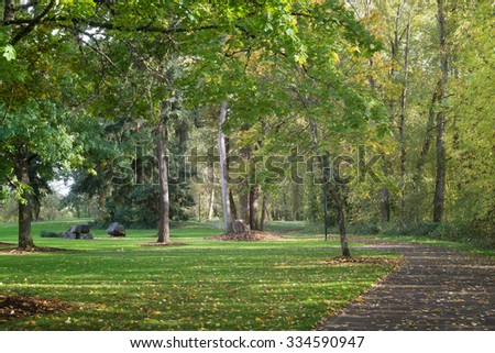 A bucolic urban park in Eugene, Oregon on a bike trail in the fall. - stock photo