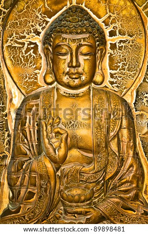 A Buddha sitting on lotus and blessing a lotus urn. - stock photo