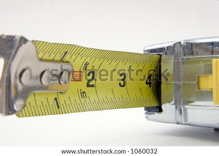 A builder's tape measure - stock photo