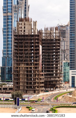 A building under construction in Business bay, Dubai, in a rainy day. - stock photo