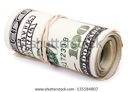 A bunch of 100 American Dollars money notes rolled up and held together with a simple rubber band. Isolated on white background. - stock photo