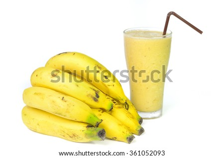 a bunch of bananas and smoothie on white background - stock photo