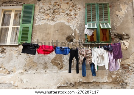 A bunch of clothes hanged on a line of string - stock photo