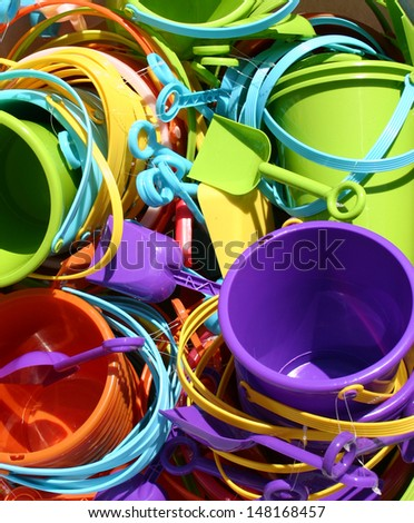 A bunch of colorful beach toys in the sun - stock photo