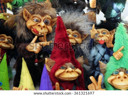 A bunch of different colorful little cute trolls - stock photo