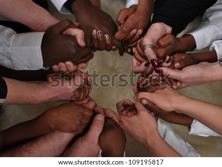 A bunch of different hands in a circle - stock photo