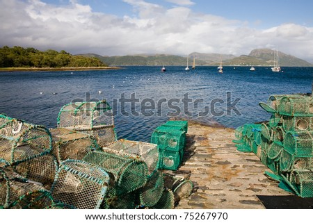 A bunch of fishing nets in Plockton harbour in the Highlands of Scotland - stock photo