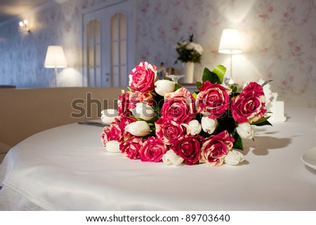 A bunch of flowers on a restaurant table - stock photo